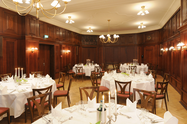 Festively decorated banquet hall with wood pannelling